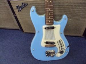 Blue Hagstrom Guitar with Fender Amp